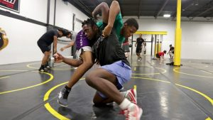 City Kids Wrestling Club is something other than a wrestling program — for a few, it's a day to day existence transformer